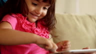 Close Up of Happy Girl Toddler Touching Tablet Screen