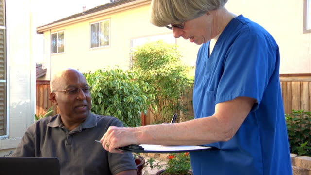 Close up of healthcare worker and patient's