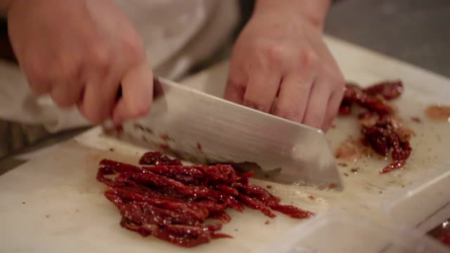 close up of human hand cutting meat for Prepar food