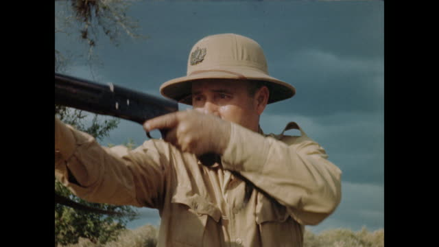 Close Up of Hunter Shooting Rifle