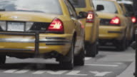 Close up of line of yellow cabs