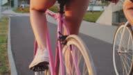 Close up of loving couple riding on bike