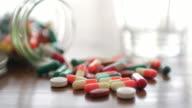 Close up of Medicine Prescription Bottles & Pills , Medical Concept , Dolly shot left to right