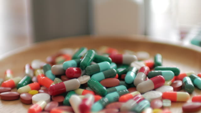 Close up of Medicine Prescription Bottles & Pills , Medical Concept , Dolly shot