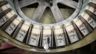 Close up of money printing press Newly redesigned $100 notes are printed at the Bureau of Engraving and Printing on May 20 2013 in Washington DC The...
