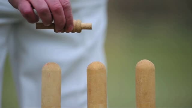 Close up of player putting wickets in place England in Spring on April 01 2013 in Nottingham England
