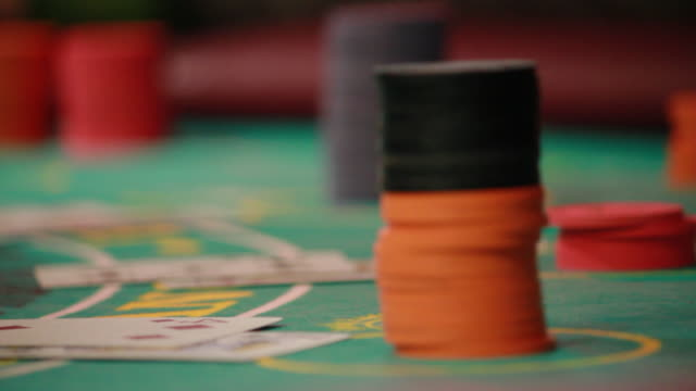 close up of poker chips on a table