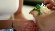 Close up of putting a floral bracelet