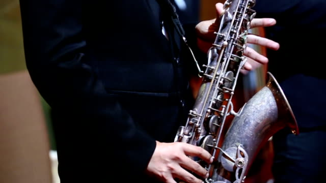 Close up of saxophone players : HD VDO
