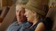 Close up of senior couple talking on lounge chairs / Idaho, United States