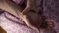 Close up of senior woman rubbing hands