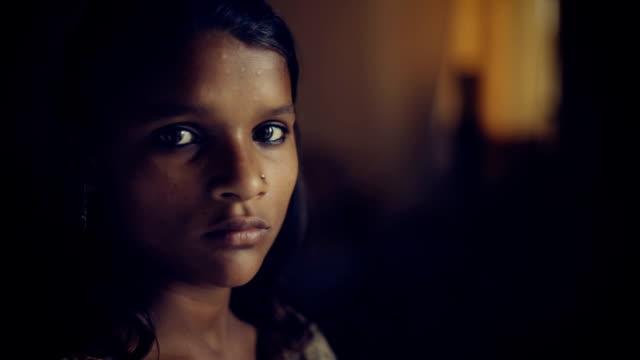 Close up of serene Indian girl thinking.