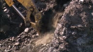 close up of shovel in coal mine