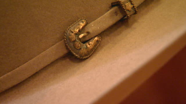 Close up of small buckle on hat