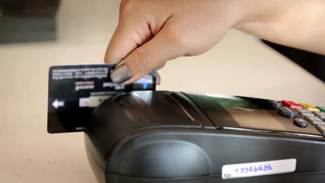 Close up of Swiping A Credit Card,Dolly Shot
