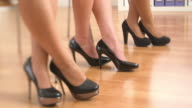 Close up of three business women's feet in high heels