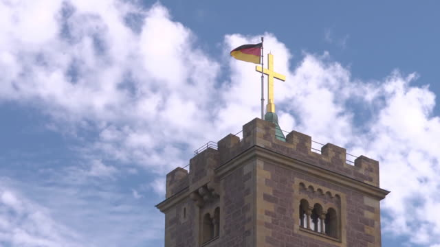 close up of tower of Wartburg Castle with flag of Germany