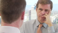 Close up of two businessmen talking in office