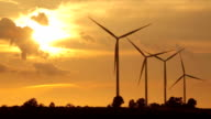 Close up of wind turbines on sunset