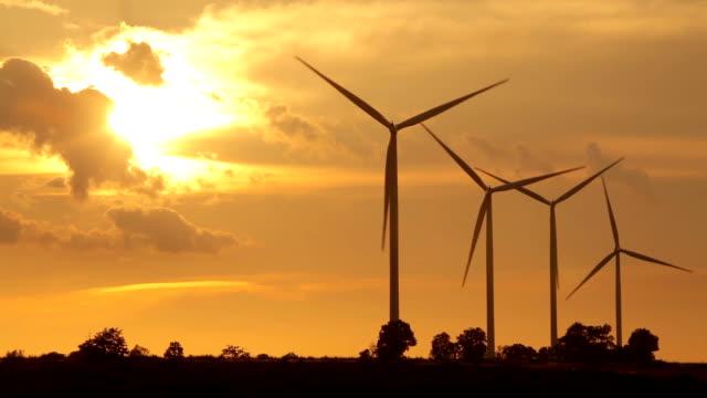 Close up of wind turbines on sunset