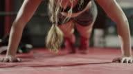 Close up of woman doing push-ups / Lehi, Utah, United States