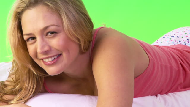 Close up of woman lying on bed