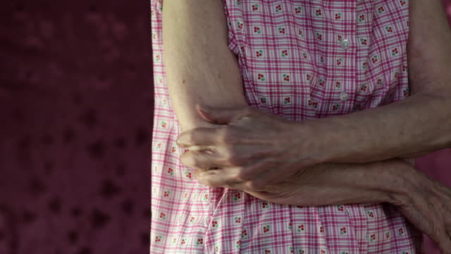Close up of woman rubbing arm