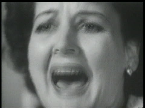 B/W 1950 close up of woman screaming in terror