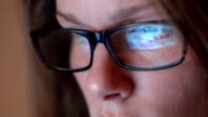 Close Up Of Woman With Glasses Using Computer