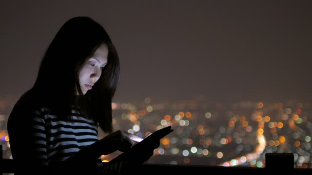 Close up of young woman touching tablet on roof top at hotel , 4k(UHD)