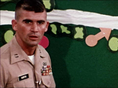 1973 close up Oliver North using magnets and describing Army tactics at chalkboard