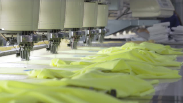 Close up on an embroidery machine at a fabric factory