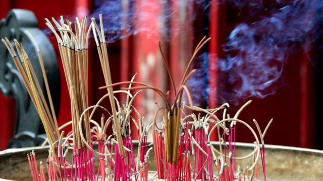 Close Up On Burning incense In A Temple, Vietnam
