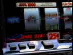 Close up pan slot machine hitting jackpot