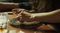 Close up panning shot of woman arranging cocaine into lines / Springville, Utah, United States