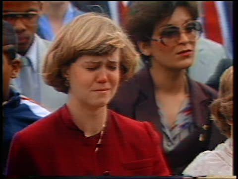 1986 close up PAN people mourning for Challenger astronauts at memorial service during eulogy