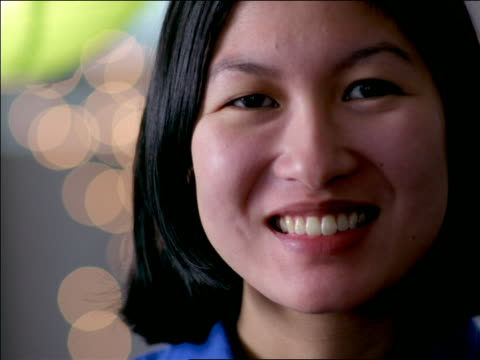 close up PORTRAIT face of Asian woman smiling at camera