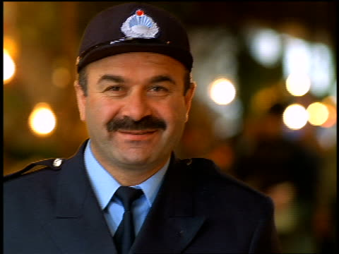 close up PORTRAIT middle-aged man with mustache in security guard uniform + hat / Istanbul, Turkey