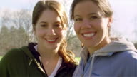 Close up portrait two young women in sweats/ Maine