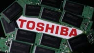 Close up pull focus a Toshiba Corp logo is seen under Toshiba Corp memory chips on memory modules in an arranged video in Tokyo Japan on Thursday Aug...