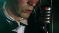 close up - puppet man sings