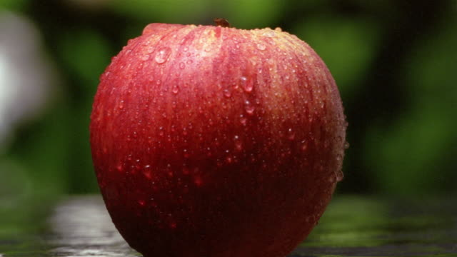 Close up red apple being cut in half