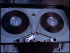 close up reel-to-reel tape spinning in large machine / Brazil