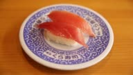 Close up salmon sushi sit on a dish inside a Kura Corp sushi restaurant in Kaizuka Osaka Japan on Thursday Aug 17 A selection of salmon sushi and...