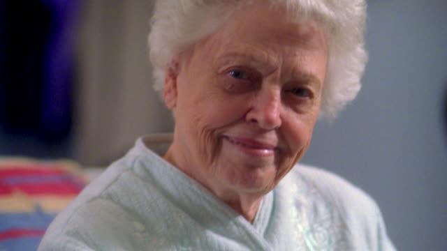 Close up senior woman looking at CAM and smiling