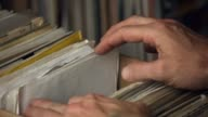 Close up shot - flicking through 7 inch singles