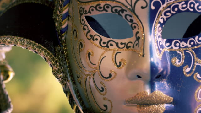 Close up shot of an artistic carnival mask blowing in the wind.