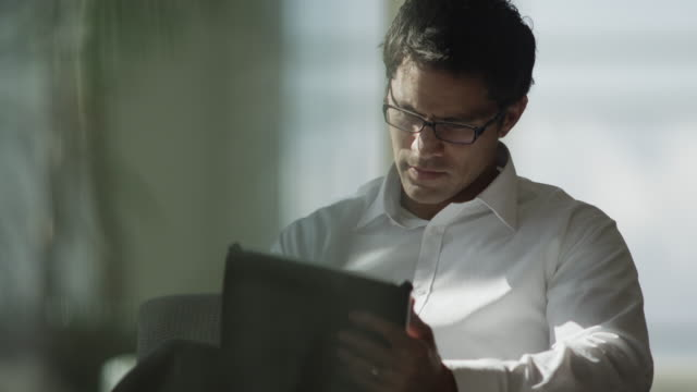 Close up shot of businessman using digital tablet / Provo, Utah, United States,