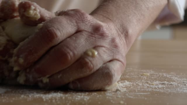 Close Up Shot Of Hands Kneading A Cheesecake Dough