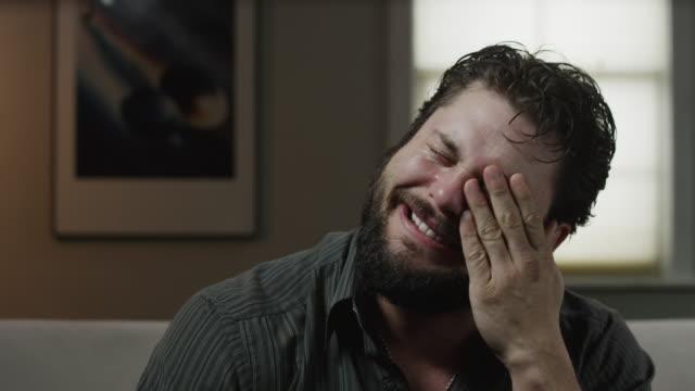 Close up shot of man talking, crying and rubbing his face / Orem, Utah, United States,